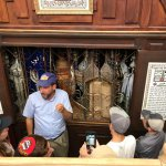 Rav Simchaa Hochbaum tells the history of the ancient torah scrolls in the Avraham Avinu shul in Hebron