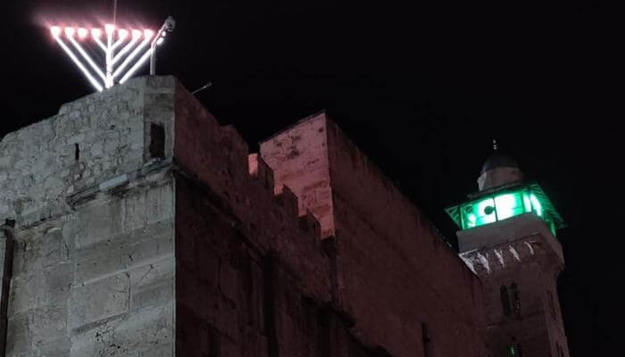Chanukah Menorah lit up on top of Ma'arat HaMachpela, the Tomb of the Forefathers and Mothers, in Hebron Israel.